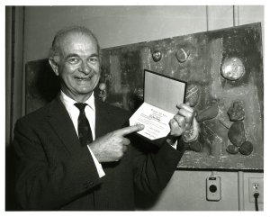 Linus Pauling posing with his ho norary high school diploma, 1962.