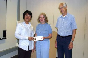 Higuchi with Judith and Peter Freeman, sponsors of the Resident Scholar Program.