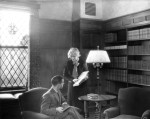 Lucy M. Lewis assisting a patron in the McDonald Room,1934.  Lewis was University Librarian from 1920-1945.  During her tenure the library, among other advancements, made the switch from Dewey Decimal classification to the Library of Congress schema.