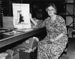 Harriet Moore, the first University Archivist, holding a historic copy of the student newspaper, 1965.