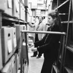 University Archivist Rolf Swensen and staff member Anne Merydith-Wolf working in the basement of the Administration Building, ca. 1979.