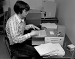 A University Archives student microfilming records, ca. 1970s.