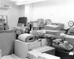 Archives staff member Anne Merydith-Wolf in the basement store room, Administration Building, ca. 1980.