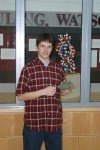A Special Collections student holding a piece of the original Watson & Crick DNA model in the Special Collections display foyer, January 2003.