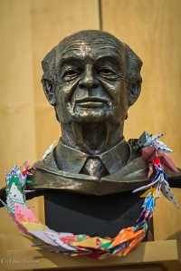 Bust of Pauling with a lei of peace cranes.  Image courtesy of Mina Carson.