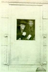 Ava Helen and Linus peeking through a train window, Spring 1938.