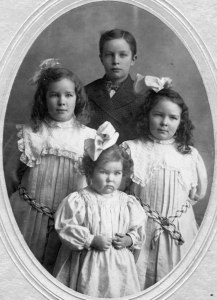 Mervyn Stephenson with his three sisters, Condon, Oregon, ca. early 1900s.