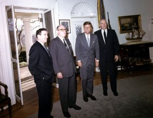 Jerome Wiesner, Joseph McConnell, John F. Kennedy and Harlan Cleveland in the Oval Office. Photograph by Cecil Stoughton. Original held in the John F. Kennedy Presidential Library and Museum, Boston.