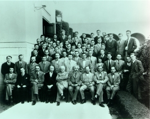 Group photo of Caltech Physics faculty and graduate students, taken on the occasion of a visit to Pasadena by Albert Einstein, 1931. Robert Oppenheimer sits in the front frow, far left.