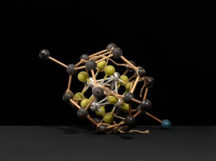 """A """"tinker toy"""" molecular structure with rope. The rope was, perhaps, used to hang the model for display. Alternatively, it may have been used to demonstrate properties of bond valence. Ca. 1950s."""